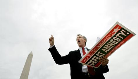 Rep. Virgil Goode, R-Va., speaks near the Washington Monument during a rally sponsored by the Minutemen Project against immigration legislation in 2007. Goode's seat remains too close to call.