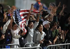 Supporters of Democratic presidential candidate Barack Obama cheer early Tuesday evening at Grant Park in Chicago, where Obama will address a rally of more than 1 million people. As expected, the Associated Press has called Illinois for Obama.
