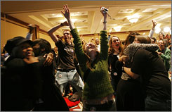 Supporters of President-elect Barack Obama react to his victory at the Indiana Democratic Party election night event in Indianapolis on Nov. 4, 2008.