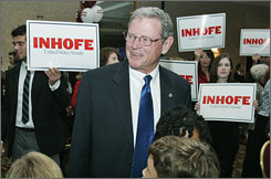 Republican Senator James Inhofe talks with supporters at a results-watching party on Tuesday night as he was re-elected for his third full term