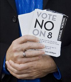 "Rick LeBlanc holds up ""No on 8"" flyers Tuesday in San Francisco. The proposition, if approved, would restrict marriage to heterosexual unions in the state."