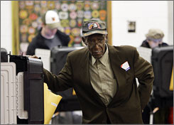 Election official Francis Pennington waits to assist a voter polling station in Baltimore.