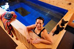 A sufferer of migraines for the last decade, Jeanne Safer, 61, a New York psychotherapist, swims at her pool in her country home in Kerhonkson, N.Y., to help ease the pain.