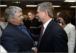 North Dakota Gov. John Hoeven, right, and State Sen. Bob Stenehjem, R-Bismarck, congratulate each other at the election night party in Bismarck, N.D., on Nov. 4, 2008. Hoeven won a third term and Stenehjem, the Senate majority leader, was re-elected.