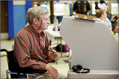 Sen. Tim Johnson, D-S.D., casts his vote at the National Guard Amory in his hometown of Vermillion, S.D.