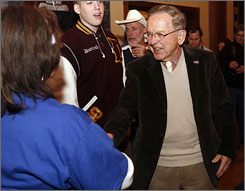 Republican incumbent Sen. Ted Stevens, greets supporters in Anchorage on Tuesday. Stevens is running against Democrat Mark Begich for one of the two Alaska Senate seats and is currently leading by four points with 36% of precincts reporting.