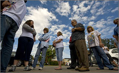 Voters line up outside a polling station in Galveston, Texas. Voter turnout has been light as residents are still in the process of rebuilding after Ike.