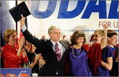 Mark Udall, left, and his wife Maggie Fox celebrate after the strong environmental advocate won a ferocious fight for the senate.
