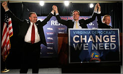 Virginia Gov. Tim Kaine, left, Mark Warner, center, and Sen. Jim Webb celebrate Warner's senate race victory in McLean, Va.