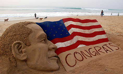 A sand sculpture of President-elect Barack Obama, created by Sudarshan Pattnaik, is seen on the beach in Puri, India, Wednesday.