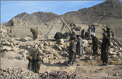 Afghan men work on a house destroyed by an alleged U.S. airstrike in Kabul, Afghanistan.