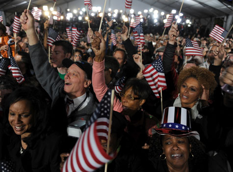 People monitoring the outcome of the general election in Chicago's Grant Park cheer after learning Democrat Barack Obama had been pronounced the winner.