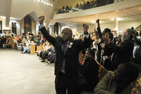 Rep. John Lewis, D-Ga., celebrates at Ebenezer Baptist Church, where Martin Luther King Jr. preached, as election results roll in Tuesday. Lewis said he was hardly able to believe that more than 40 years after he was left beaten and bloody on Pettus bridge, he had voted for a victorious Obama.