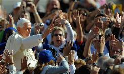 Pope Benedict XVI waves to people in St Peter's Square the day after Obama was elected president of the United States.