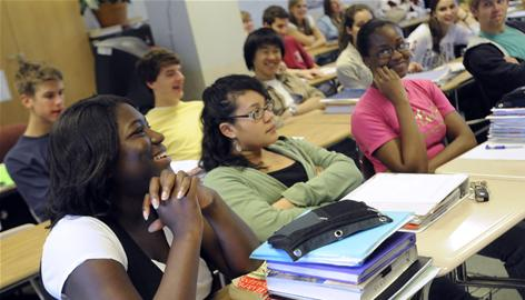 Towson High School seniors, from front left, Janelle Asiedu, Sara Lincoln and Pearl Amaechi, participate in a discussion of the presidental election results during an economics class Nov. 5 in Towson, Md.
