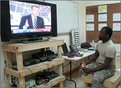 Sgt. Urban Jones of 2nd Battalion, 30th Infantry Regiment monitors election returns early Wednesday in Baghdad.