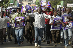 People in Kisumu, Kenya, celebrate the victory of Barack Obama on Wednesday. Africans stayed up all night Tuesday to learn that Americans elected their first black president.