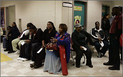 Voters line up on Tuesday, Election Day, at an elementary school serving as a voting precinct in Atlanta. The Georgia secretary of state is reporting Fulton County, Ga., officials to the state for sending workers home before all ballots were counted.