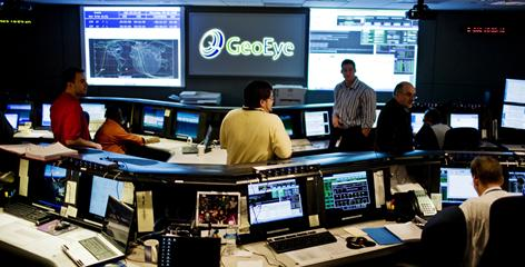 GeoEye employees wait in an operations center in Dulles, Va., for the next pass of a satellite over Antarctica.