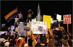 Protestors aganist California's gay marriage ban demonstrate Thursday in front of the Church of Jesus Christ of Latter-day Saints in Los Angeles.
