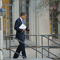 President-elect Barack Obama leaves a parent-teacher conference Friday at the University of Chicago Lab School.