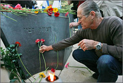 An Israeli man pays his respects by the grave of the late Israeli Prime Minister Yitzhak Rabin, after a memorial ceremony marking the 13th anniversary of his assassination in Jerusalem, Tuesday.