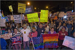 Thousands of demonstrators march on the streets of Los Angeles to protest Proposition 8, an amendment banning same-sex marriage.