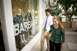 Emily Becker, 28, and husband Joe Becker, 29, window-shop near Emily's San Francisco office during their lunch break.