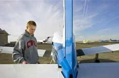 Dustin Oftedal, 21, goes over his pre-flight checklist as he gets ready for his lesson at Big Bend Community College in Moses Lake, Wash. Oftedal transferred from the community college to Central Washington University to complete his bachelor's of science degree in aviation.