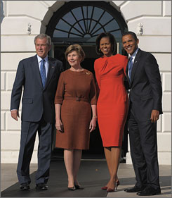 President Bush and first lady Laura Bush greet President-elect Barack Obama and his wife Michelle at the White House on Monday.