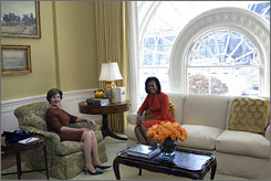 First lady Laura Bush, left, and her successor, Michelle Obama, sit in the private residence of the White House on Monday. Obama toured her soon-to-be home while her husband, President-elect Barack Obama, met with President Bush.