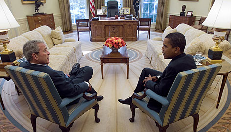 U.S. President George W. Bush and President-elect Barack Obama meet in the Oval Office of the White House on Monday.