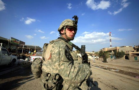 U.S. Army Spc. Kevin Mowl of Pittsford, N.Y., on patrol in February 2007, six months before being seriously injured.