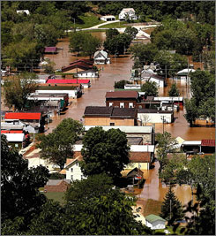 In June: Floodwaters cover downtown Gays Mills, Wis. Many homes and neighborhoods remain deserted.