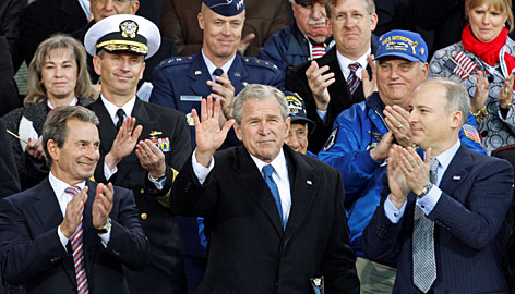 President Bush, center, rededicates the Intrepid Sea, Air and Space Museum in New York on Tuesday, Nov. 11. Intrepid Museum co-chairmen Richard Santulli, left, and Charles de Gunzberg flank the president.