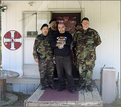 Ronald Edwards, center, stands with guards at the Imperial Klans of America's 28-acre compound in Dawson Springs, Ky.