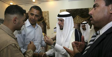 During a July 22 trip to Ramadi, Barack Obama, second from left, spoke with a tribal sheik, third from left, with the help of a translator. 