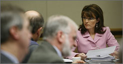 Alaska Gov. Sarah Palin returned to her daily duties after a failed bid at the presidency as Sen. John McCain's running mate.
