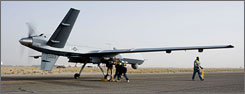 A crew checks an MQ-9 Reaper before it takes off for a mission in Afghanistan.
