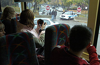 Tourists on the Gray Line Bus Tour pass a security road block near the home of President-elect Barack Obama in the Chicago's Kenwood neighborhood.