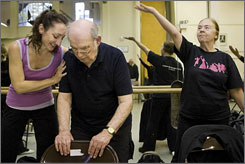 From right, Janet Flanagan, 66, Frank Flanagan, 85, and Misty Owens, a faculty member of the Mark Morries Dance Group, work on dance steps.