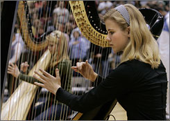 Elizabeth Smart, here playing the national anthem before a Utah Jazz game, was abducted from her Salt Lake City bedroom in June 2002 and found in March the following year.