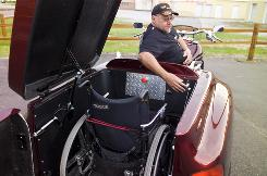 Larry Curry, 53, of Dyersburg, Tenn., was born with no legs. This Boss Hoss Advantage Trike was designed specifically for him.
