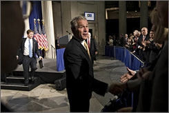 "President  Bush greets attendees following his speech at Federal Hall National Memorial Thursday in New York City. Bush urged leaders of the world's biggest economies not to abandon free- market capitalism as they seek an escape from the financial crisis, calling it the '""best system'"" for delivering growth."