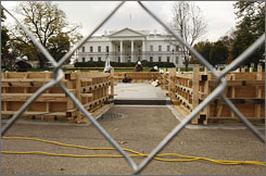 With the White House in the background, workers continue to build the Presidential inauguration reviewing stand in Washington, on Nov. 7. On January 20, 2009, President Obama and guests will view the inaugural parade from the stand.