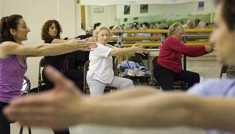 Hilma Griffis, 72, center, who has Parkison's disease, participates in a dance class in London. Through a partnership with the Brooklyn Parkinson's Group, dancers from Mark Morris Dance Group lead weekly customized dance workshops for people with Parkinson's and their caregivers.