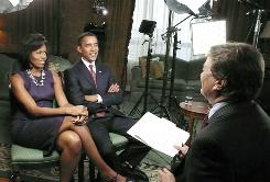 "President-elect Barack Obama and his wife Michelle describe the moment when the reality of his victory hit home in their first post-election interview. The talk, which covered a variety of issues, including the economy, will air Sunday on ""60 Minutes."""