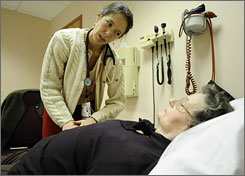 Rachel Broudy, left, director of the Elder Service Plan of the Cambridge Health Alliance in Cambridge, Mass., examines patient Theresa Doherty, 76, Nov. 6. A program called PACE provides concierge medicine for elderly and poor people. The government gives this program the money it would give to Medicaid, and PACE provides its patients all health services.