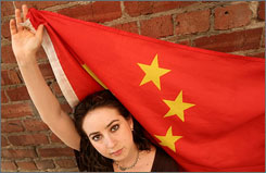 Melissa Sconyers, who studied abroad in China, is photographed with a Chinese flag in San Francisco Aug. 11. China is the seventh most popular destination for U.S. students, according to the Institute of International Education.