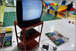 Students at Central City Elementary School play in the background, right, after their Physical Education teacher was unable to start the Dance Dance Revolution 2 video game system, seen at left, in November 2006, in Huntington, W.Va. The CDC just named West Virginia as the state with the poorest health in the nation. Makers of the video game, Konami, say West Virginia is the first state in the country to integrate the game into its public health strategy. Teachers have reported technical difficulties in using the game for a fitness program.